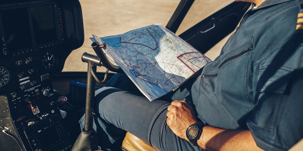 helicopter-pilot-reading-map-PR88REB